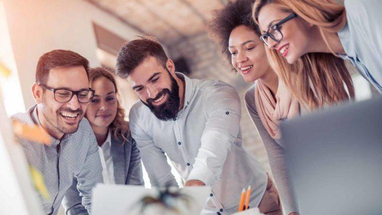 People-above-office-desk-smiling-prestige digital solutions